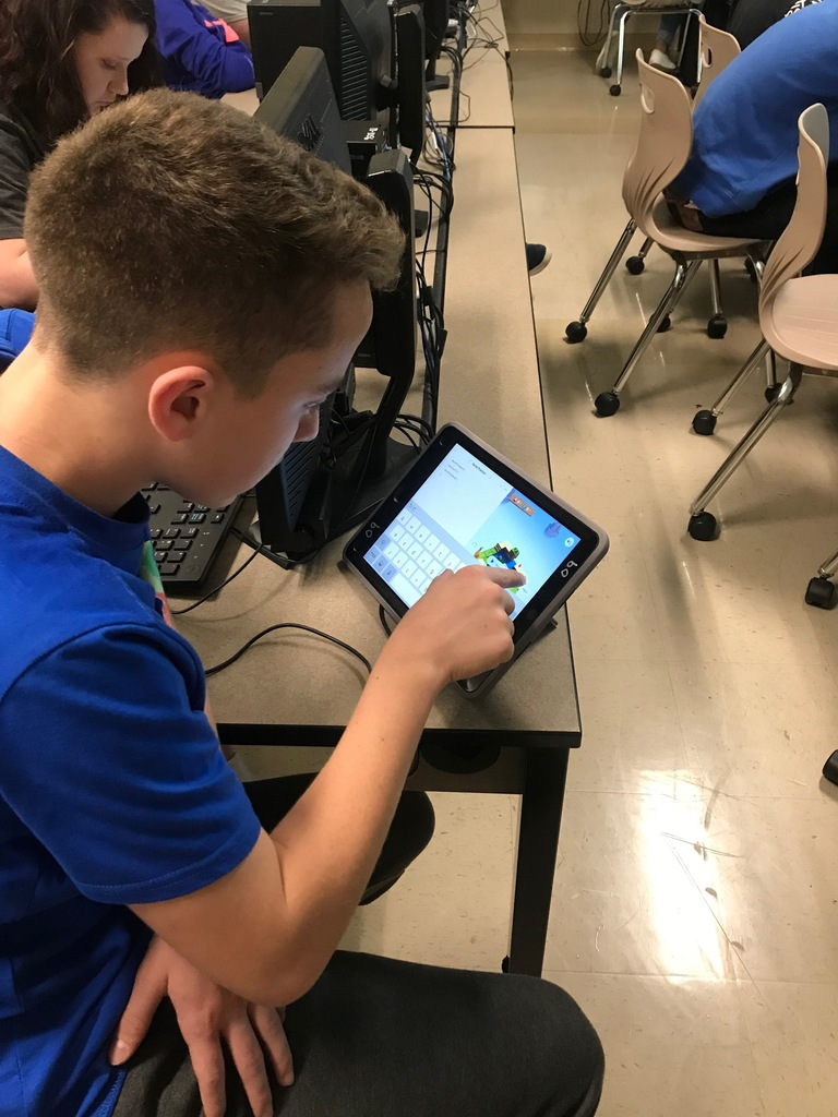 Student coding on an IPAD.