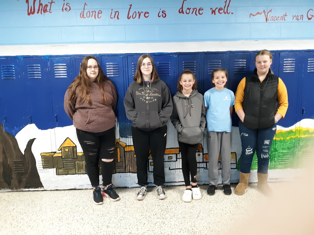 art club students standing in front of project