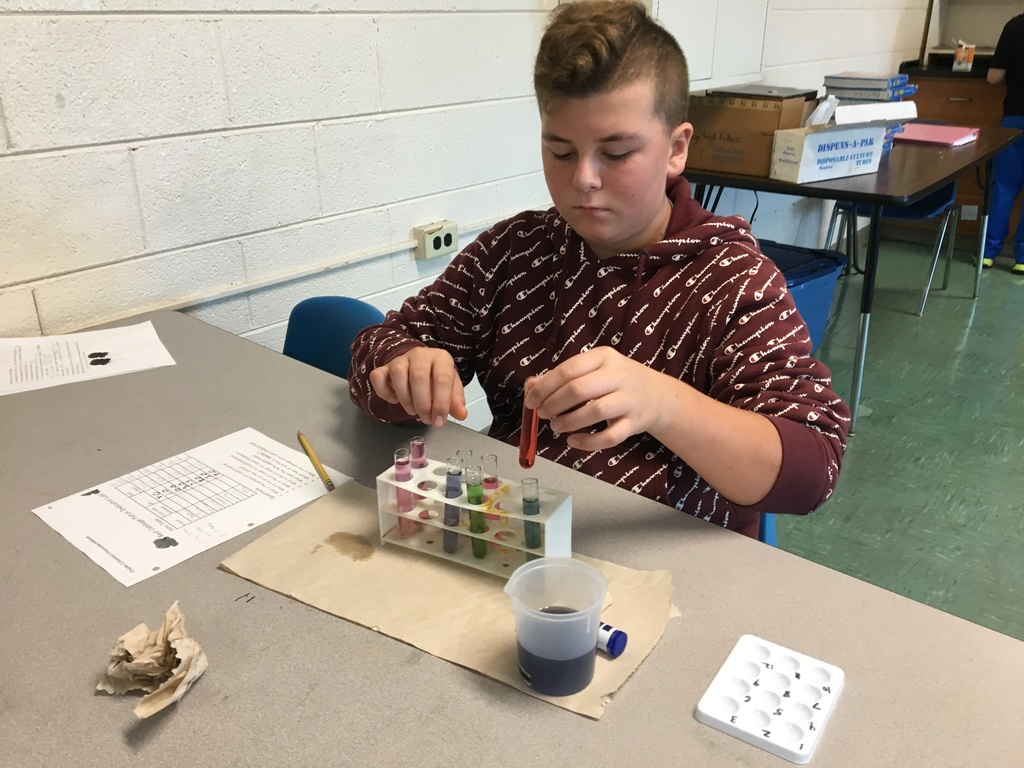 student using vials for lab