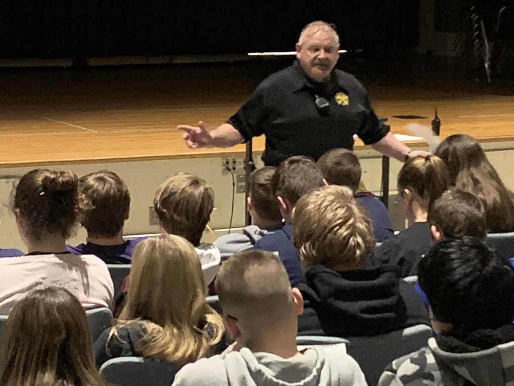 Deputy Conley speaking to PE Classes