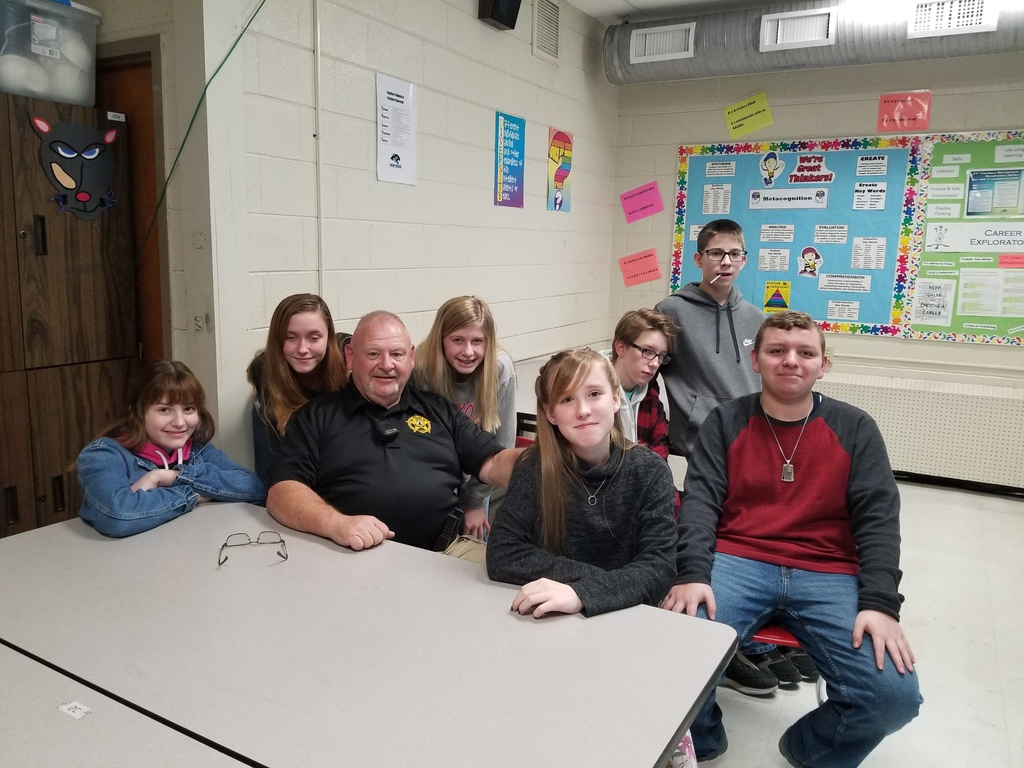 Officer Conley with 8th grade students for Forensic Science Unit